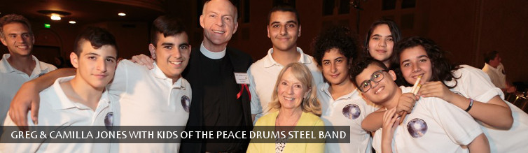 Greg & Camilla Jones with kids of the Peace Drums Steel Band